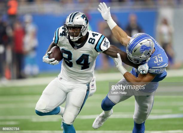 Ed Dickson of the Carolina Panthers fights off Miles Killebrew of the Detroit Lions during the first half at Ford Field on October 8, 2017 in...