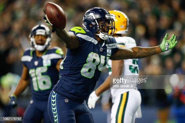 Ed Dickson of the Seattle Seahawks celebrates a touchdown in the fourth quarter at CenturyLink Field on November 15 2018 in Seattle Washington