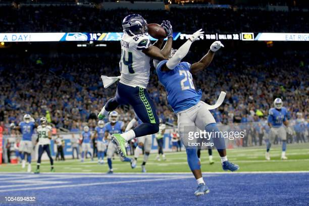 Ed Dickson of the Seattle Seahawks make a touchdown catch over Quandre Diggs of the Detroit Lions during the second quarter at Ford Field on October...