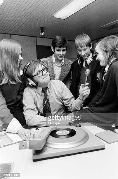 Ed Doolan BRMB Radio Disc Jockey pictured with news boys and girls Birmingham 14th January 1975