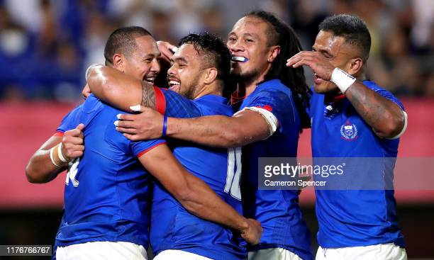 Ed Fidow of Samoa celebrate scoring his sides third try with his team mates during the Rugby World Cup 2019 Group A game between Russia and Samoa at...