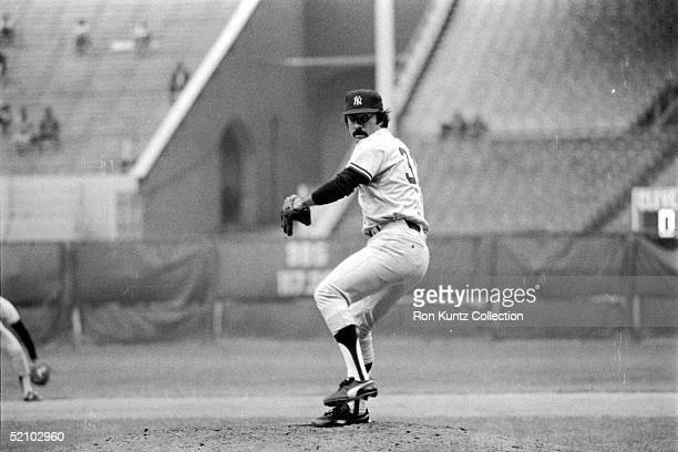 Ed Figueroa of the New York Yankees delivers a pitch during a game against the Cleveland Indians on August 17 1978 at Municipal Stadium in Cleveland...