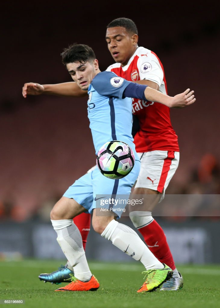 Ed Francis of Manchester City holds off Donyell Malen of Arsenal during the Premier League 2 match between Arsenal and Manchester City at Emirates Stadium on March 13, 2017 in London, England.