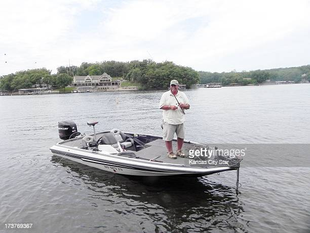 Ed Franko a fishing guide at Lake of the Ozarks fished for bass on a hot summer day