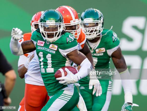 Ed Gainey of the Saskatchewan Roughriders runs with the ball after making his second interception of the first half in the game between the BC Lions...