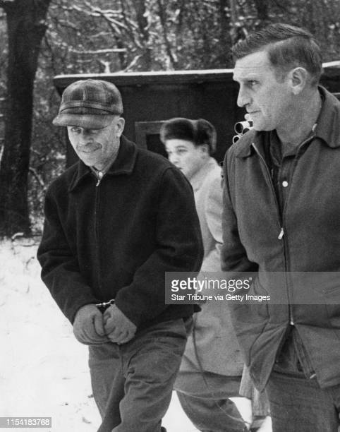 Ed Gein a Wisconsin was led away by Sheriff Arthur Schley near Plainfield Wisconsin in 1957 after he admitted to murdering two women and robbing...