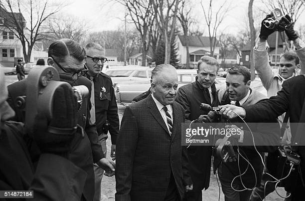 Ed Gein, accused of grave robbery and the murder of two women in Plainsfield, Wisconsin, walks to the Waushara County Courthouse surrounded by police...