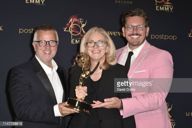 Ed Glavin Mary Connelly and Andy Lassner pose in the press room with their Emmy for Outstanding Talk Show at the 46th Annual Daytime Emmy Awards at...
