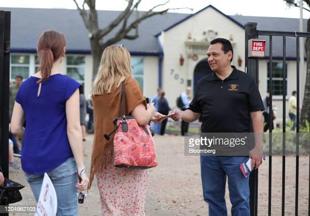 Ed Gonzalez, sheriff seeking re-election for Harris County, speaks to voters outside a polling station in Field Elementary School in Houston, Texas,...