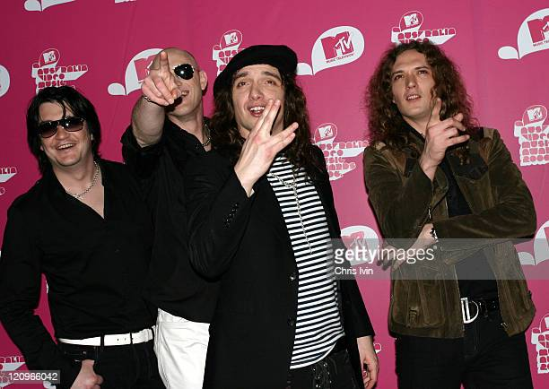 Ed Graham Richie Edwards Justin Hawkins and Dan Hawkins of The Darkness