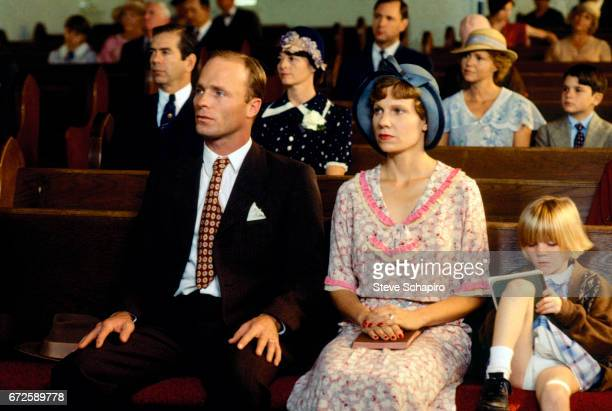 Ed Harris and Lindsay Crouse sit together in a scene from the film 'Places in the Heart' 1983