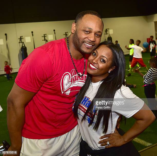 Ed Hartwell and Keshia Knight Pulliam attend Big Hart Sports and Fitness Academy Grand Opening on January 30 2016 in Duluth Georgia