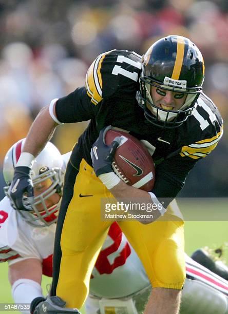 Ed Hinkel of Iowa attempts to break free from Bobby Carpenter of Ohio State October 16 2004 at Kinnick Stadium in Iowa City Iowa