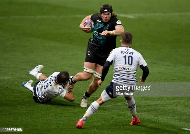Ed Holmes of Bristol Bears is tackled by Jean-Baptiste Dubié of Bordeaux-Begles during the European Rugby Challenge Cup Semi Final match between...