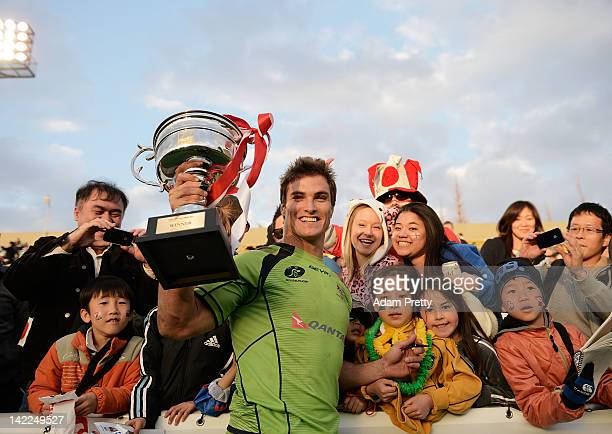 Ed Jenkins and fans celebrate winning the Cup Final over Samoa after the Samoa vs Australia Cup Final during day two of the Tokyo Sevens at Prince...