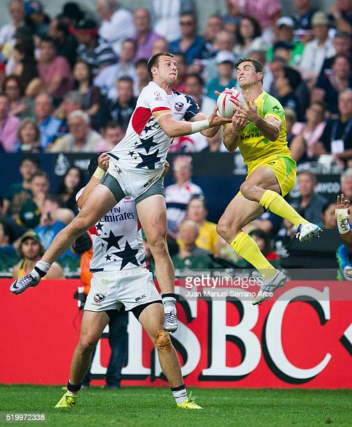 Ed Jenkins of Australia competes for the ball with Ben Pinkelman of United States during the 2016 Hong Kong Sevens match between Australia and United...