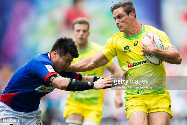 Ed Jenkins of Australia is tackled during the 2017 Hong Kong Sevens match between Australia and South Korea at Hong Kong Stadium on April 8 2017 in...