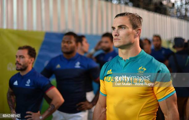 Ed Jenkins of Australia prepares to lead out his team during the Men's Rugby Sevens placing match between France and Australia on day six of the Rio...