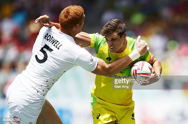Ed Jenkins of Australia puts a fend on James Rodwell of England during the 2016 Sydney Sevens Cup Quarter Final match between England and Australia...
