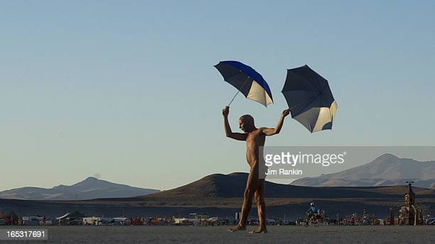 DESERT NV Ed Joseph of San Francisco performs on the Black Rock Desert during Burning Man a weeklong party and arts festival About 35000 people are...