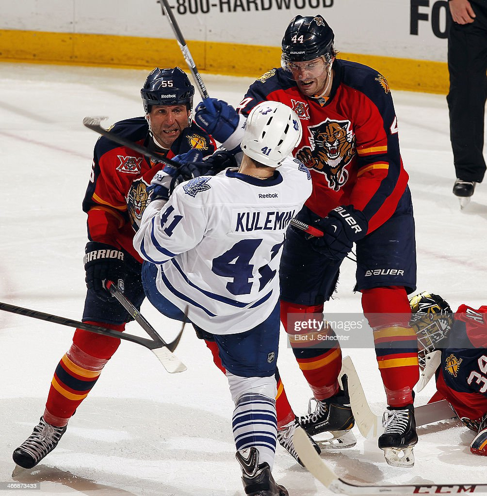 Ed Jovanovski #55 of the Florida Panthers and teammate Erik Gudbranson #44 shove Nikolai Kulemin #41 of the Toronto Maple Leafs at the BB&T Center on February 4, 2014 in Sunrise, Florida.
