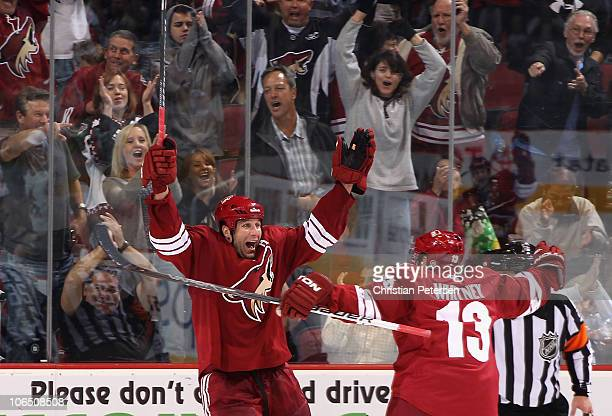 Ed Jovanovski of the Phoenix Coyotes celebrates with teammate Ray Whitney after Jovanovski scored his third goal of the night against the Nashville...