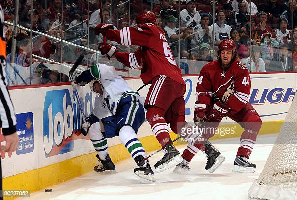 Ed Jovanovski of the Phoenix Coyotes puts a big hit on Brendan Morrison of the Vancouver Canucks on March 13 2008 at Jobingcom Arena in Glendale...