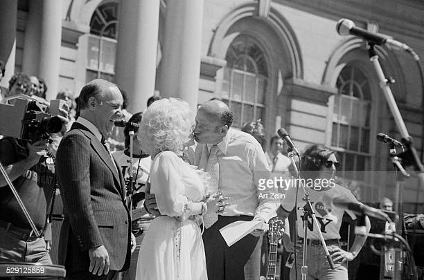 Ed Koch kissing Dolly Parton at NYC City hall after her performance circa 1970 New York