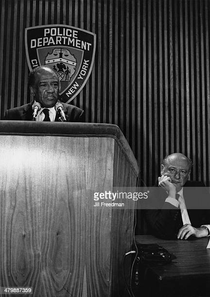 Ed Koch Mayor of New York City listens to a speech by an official of the New York Police Department circa 1978