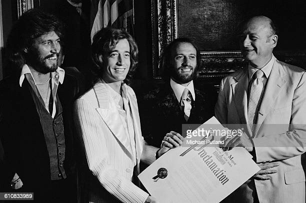 Ed Koch Mayor of New York City presents his office's proclamation of 'Disco Week' in New York to pop vocal trio The Bee Gees USA September 1978 The...