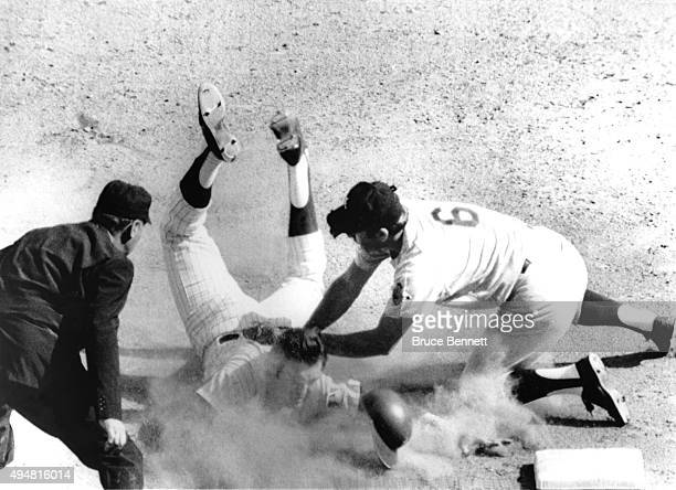 Ed Kranepool of the New York Mets is tagged out by third baseman Clete Boyer of the Atlanta Braves as Kranepool was trying for a triple in the fourth...