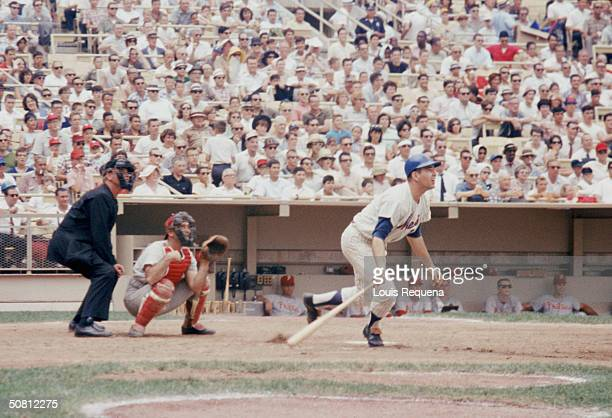 Ed Kranepool of the New York Mets watches the flight of the ball as he heads to first base during a 1965 season game at Shea Stadium in Flushing New...