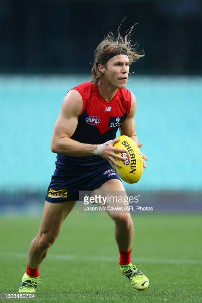Ed Langdon of the Demons in action during the round 13 AFL match between the Melbourne Demons and the Collingwood Magpies at Sydney Cricket Ground on...