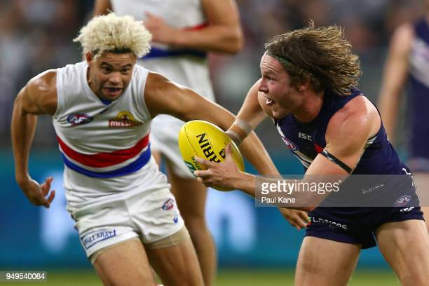 Ed Langdon of the Dockers breaks clear of Jason Johannisen of the Bulldogs during the round five AFL match between the Fremantle Dockers and the...