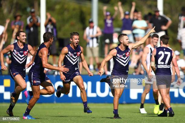 Ed Langdon of the Dockers celebrates kicking a goal after the final siren to win the 2017 JLT Community Series AFL match between the Fremantle...