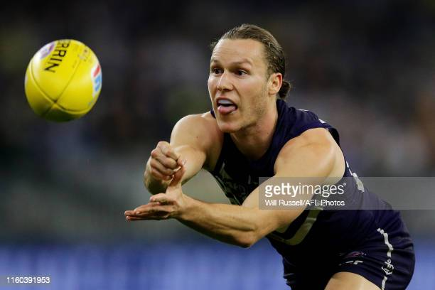 Ed Langdon of the Dockers handpasses the ball during the round 16 AFL match between the Fremantle Dockers and the West Coast Eagles at Optus Stadium...