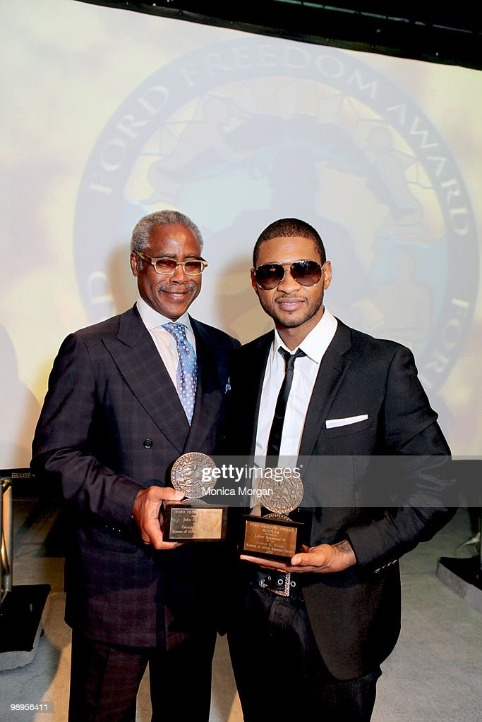 Ed Lewis, Founder and Chairman Emeritus, Essence Magazine, who accepted on behalf of the John H. Johnson family, and Usher, Scholar, pose with awards at the 12th Annual Ford Freedom Awards Scholars Lecture at the Charles H. Wright Museum of African American History on May 6, 2010 in Detroit, Michigan.