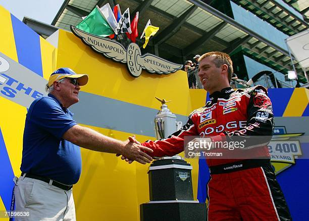 Ed Liddy CEO Allstate Insurance Company shakes the hand of Jeremy Mayfield the driver of the Dodge Dealers/UAW Dodge car at the NASCAR Nextel Cup...