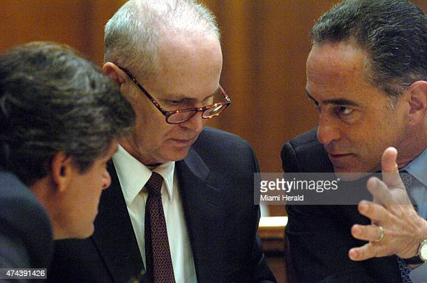 Ed Locascio center listens to his attorneys Robert Amsell right and David Raben on Feb 20 2007 during the opening day of his trial in Miami Fla...