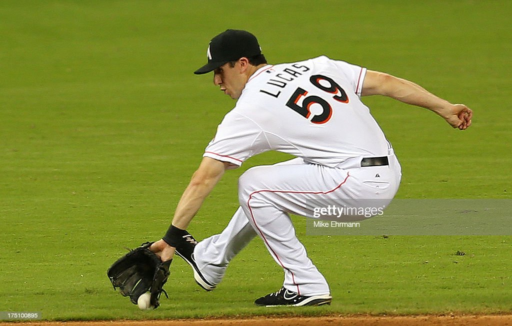Ed Lucas #59 of the Miami Marlins fields a ground ball during a game against the New York Mets at Marlins Park on July 31, 2013 in Miami, Florida.
