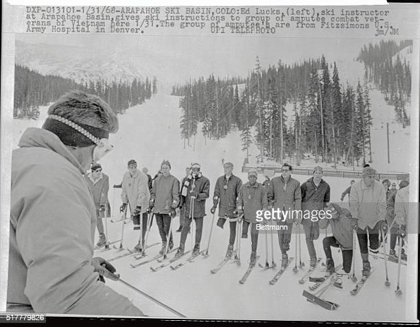 Ed Lucks ski instructor at Arapahoe Basin gives ski instruction to group of amputee combat veterans of Vietnam here The group of amputee's are from...