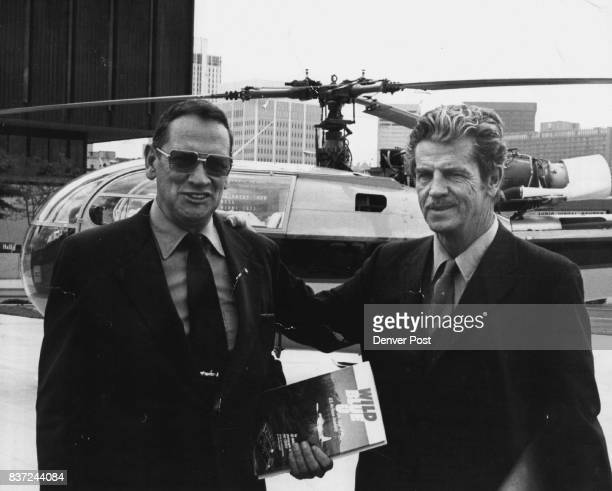 Ed Mack Miller Left and Pat Coffey arrive in Downtown Denver for autograph party They show their book Wild Blue U as they arrive at MayDF from...
