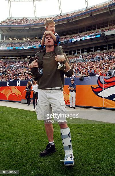 Ed McCaffrey and his son Christian watch first quarter action from the sideline during the Denver Broncos 3120 victory over the New England Patriots...