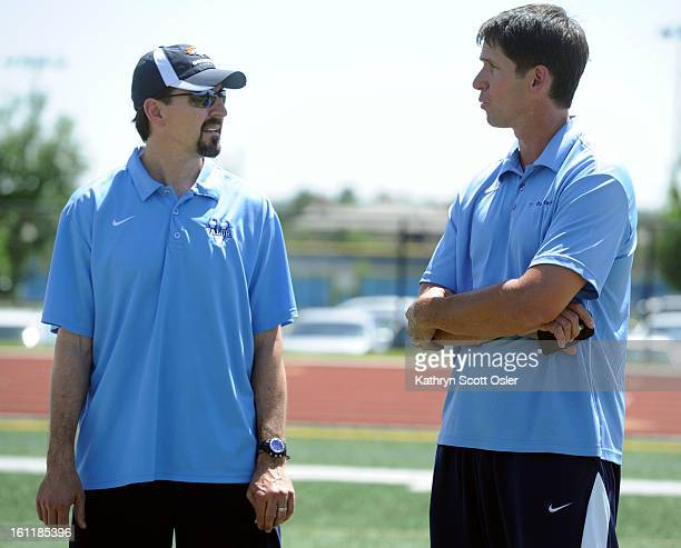Ed McCaffrey right chats with former Bronco David Treadwell on the sideline Former Denver Broncos receiver Ed McCaffrey joins the Global Down...