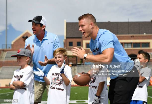 Ed McCaffrey top left and his son Carolina Panthers RB Christian McCaffrey right and campers encourage young football players at the McCaffrey...