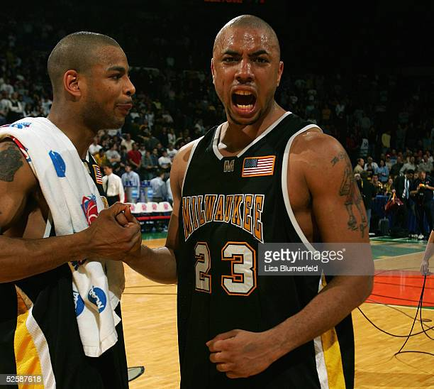 Ed McCants and James Wright of the WisconsinMilwaukee Panthers celebrate during the game with the Boston College Eagles in the second round of the...