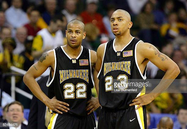 Ed McCants and James Wright of the WisconsinMilwaukee Panthers watch a free throw in a game against the Boston College Eagles during the second round...