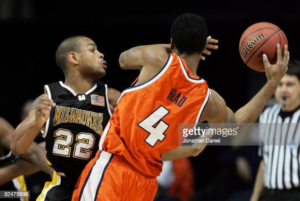 Ed McCants of the WisconsinMilwaukee Panthers reaches in to try to steal the ball from Luther Head Illinois Fighting Illini in game one of the...