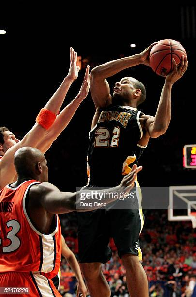 Ed McCants of the WisconsinMilwaukee Panthers shoots over the defense of the Illinois Fighting Illini in game one of the Chicago Regional in the NCAA...