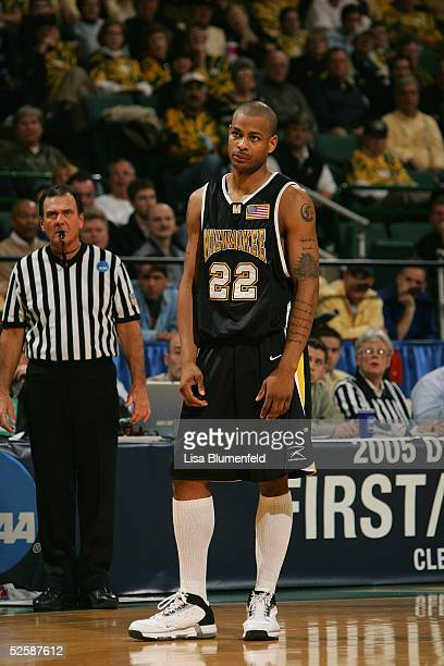 Ed McCants of the WisconsinMilwaukee Panthers stands on the court during the game with the Boston College Eagles in the second round of the 2005 NCAA...